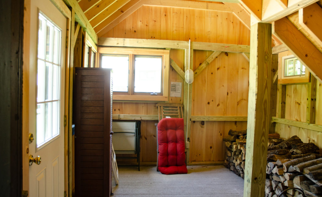 The cabin entry way and woodshed.